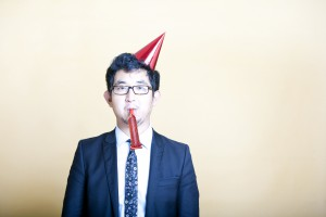 business man wearing party hat